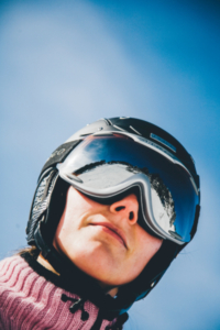 Lady ski goggles blue sky